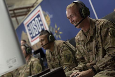 Troops playing Call of Duty: WWll. USO Photo by Joe Lee