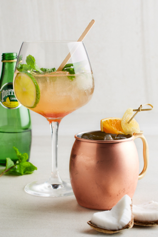 New beverages at California Pizza Kitchen include the refreshing Tropical Mule, featuring Grey Goose® vodka, RumHaven® coconut rum, ginger beer, Monin® passion fruit, and fresh agave served in a classic copper mug, as well as the non-alcoholic Sparkling Watermelon-Lime, a blend of Perrier® Lemon Sparkling Water with a light watermelon flavor, fresh mint and lime. (Photo: Business Wire)