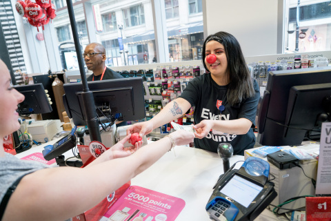 Walgreens customer purchasing a Sparkle Red Nose for $1 (Photo: Business Wire)