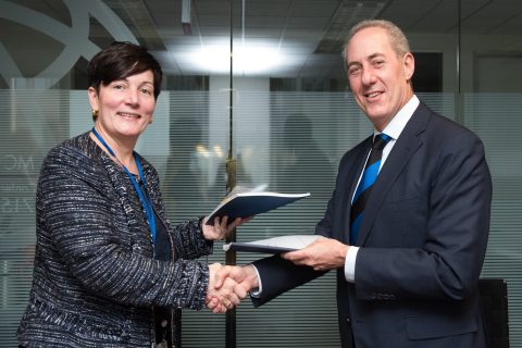 Stephanie von Friedeburg, IFC Chief Operating Officer and Michael Froman, Vice Chairman and President, Strategic Growth at Mastercard Sign Updated Agreement in Washington, DC on Sunday During the World Bank's Annual Spring Meeting. (Photo: Business Wire)