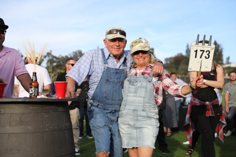 TILLYS Co-Founder and TLC Founder, Tilly (right) and her Husband Larry Levine (left) Dressed to Impress and Bidding for Live Auction Items (Photo: Business Wire)