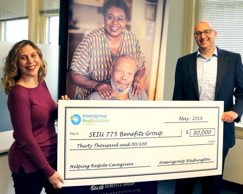 Interim Executive Director of SEIU 775 Benefits Group Abby Solomon receives $30,000 contribution from Amerigroup Washington President Craig Smith. This contribution will be used to develop and offer a respite care online training, which will illustrate the unique needs required to bring respect and dignity for those Washington residents who are being cared for, and will ultimately provide stress relief for caregivers. (Photo: Business Wire)