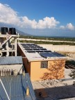 A portion of the solar panels that SolarWorld Americas Inc. donated to a Hope for Haiti's Children orphanage and school at Thomazeau, Haiti, sits atop the children's dormitory. (Photo: Business Wire)