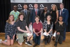 Dolan Middle School students with (top row, L-R) (pictured 2nd) Altice USA Chairman and CEO Dexter Goei, (pictured third) U.S. Senator Richard Blumenthal, (pictured fifth) Principal Charmaine Tourse and (pictured sixth) Moderator Eric Landskroner (Photo: Business Wire)