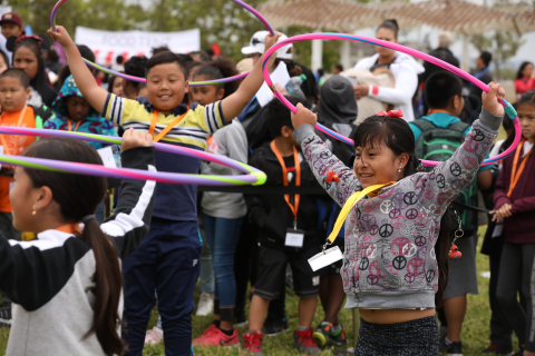 "Dan and Madeline (left to right), third-graders from Franklin Elementary School in Oakland hula hoop during an activity to teach kids about the importance of active lifestyles. More than 500 children attended a health festival at Estuary Park in downtown Oakland on Thursday, May 3, 2018. The event – hosted by Blue Shield of California and the American Heart Association – kicked off ""Make Time for Health Program,"" a three-year initiative to encourage Oakland elementary students to improve their heart health by focusing on tobacco-free lifestyle, increased physical activity and balanced nutrition. (Photo: Business Wire)"