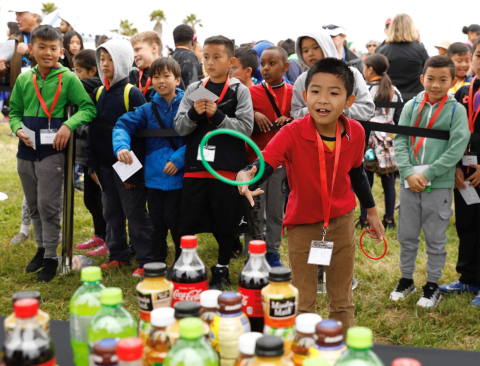 "Minh, a student at Lincoln Elementary School, tosses the ring at a station where he learned about sugary snacks at a health festival for Oakland children. More than 500 Oakland elementary students attended a health festival at Estuary Park in downtown Oakland on Thursday, May 3, 2018. The event – hosted by Blue Shield of California and the American Heart Association – kicked off ""Make Time for Health Program,"" a three-year initiative to encourage Oakland elementary students to improve their heart health by focusing on tobacco-free lifestyle, increased physical activity and balanced nutrition. (Photo: Business Wire)"