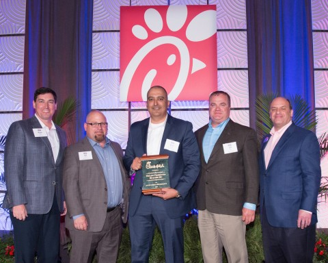 Left to Right: Brian Wray of Chick-fil-A, Bill Jarvis, Rene Acuna and Jeff Bass of McLane and Tim Tassopoulos of Chick-fil-A. (Photo: Business Wire)