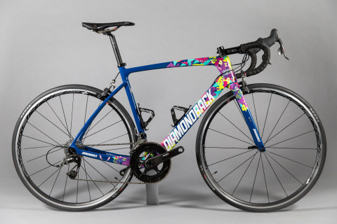 """The custom-designed, hand-painted """"Hip-Hop Dance"""" bike will be ridden in the 2018 Amgen Tour of California by Robin Carpenter in honor of UHCCF grant recipient Tatiana. The bike is one of six being auctioned online during the tour with all proceeds benefiting UnitedHealthcare Children's Foundation (Photo: Rally Cycling)."""