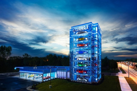 Carvana debuted its ninth Car Vending Machine in Charlotte, North Carolina. The all-glass tower stands eight stories high and holds up to 32 vehicles, serving as a fun and unique pickup experience for customers. (Photo: Business Wire)