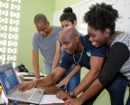 Ricardo Allen, CEO, One to One, demonstrates Flow Study Portal to students in Anguilla. (Photo: Business Wire)