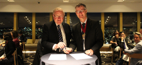 Dr. Michael A. E. Ramsay, Patient Safety Movement Board Member, (left) and ANZCA President, Professor David A. Scott (right), sign ANZCA's Commitment to Action Letter (Photo: Business Wire)