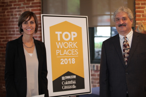 Fiona Cantrell, Vice President of Financial Services, Seibels, and Steve Armato, Vice President of Human Resources, Seibels, accept a 2018 Top Workplaces Award at a ceremony in Greenville, South Carolina. (Photo: Business Wire)