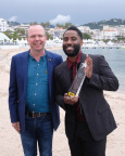 John David Washington (pictured with IMDb Founder and CEO Col Needham) receives the IMDb STARmeter Award in the Breakout category at the 71st Annual Cannes Film Festival. Photo by Getty Images for IMDb.