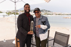 John David Washington (pictured with BlacKkKlansman director Spike Lee) receives the IMDb STARmeter Award in the Breakout category at the 71st Annual Cannes Film Festival. Photo by Getty Images for IMDb.