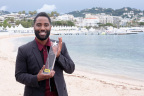John David Washington receives the IMDb STARmeter Award in the Breakout category at the 71st Annual Cannes Film Festival. Photo by Getty Images for IMDb.