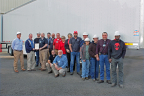 Standing left to right: David Neighbors-Plant Manager, Dale Innis-Liberty Mutual, Chad Hale-Axle Line, Sean Graddy-EHS Manager, Chris Pindell-Materials Manager, Jeremy Dogan-Quality Control Manager, John Oliver-Plant Superintendent, Darla Smith-Accounts Payable, Suzie Watkins-EHS Clerk, Chris Clemons-EHS Department, Scott Taylor-Paint Tech., Monica Thompson-Front Walls, Laura Mayberry-AX, Ben Butler-EHS Tech., and Derrick Douglas-Material Handler. Kneeling left to right: Joe Upchurch-Fabrication/Process Improvement Manager, Scott Maxwell-HR Manager. (Photo: Business Wire)