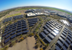 A 2017 photo shows Intel Corporation's Ocotillo, Arizona, campus, where the company has built special solar parking structures that keep employees' cars shaded from 100-degree summer temperatures and generate solar power for on-campus use. The company has installed more than 8,000 solar parking spots worldwide. New solar projects are planned or underway at many Intel campuses, including those in Ocotillo; Chandler, Arizona; India; Vietnam; and Malaysia. (Credit: Intel Corporation)