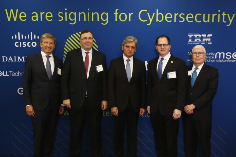 Siemens President and CEO, Joe Kaeser (Center), was joined at a Charter of Trust signing ceremony in Washington, D.C. by (L-R) Prof. Dr.-Ing. Axel Stepken, Chairman of the Board of Management of TÜV SÜD AG; Patrick Pouyanné, Chairman & CEO, Total; Michael Dell, Chairman & CEO, Dell Technologies, and Michael Timmeny, SVP & Chief Government Strategy Officer of Cisco. Signed during National Infrastructure Week, the Charter of Trust is a global cybersecurity initiative comprised of 16 members, and designed build trust in cybersecurity and further advance digitalization. Photo Credit: Bloomberg LP.