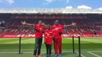 """Taking It All In: """"Here we are at Old Trafford – The Theatre of Dreams"""" one of two Flow Skills winners, 12 year Jamaican Brian Burkett (center) is flanked by his coach Mitchily Waul (left) and father, Albert Burkett (right). (Photo: Business Wire)"""