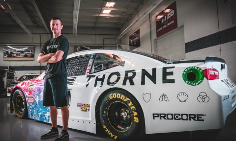 Champion Leavine Family Racing Driver Kasey Kahne stands in front of the newly wrapped Thorne-sponsored car. (Photo: Business Wire)