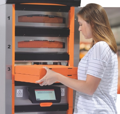 Apex Hot-Holding Device™ is the first, heated order pick-up station using self-serve automation technology. It is on display at the 2018 National Restaurant Association (NRA) Show, in booth 5870, through May 22nd. The Apex Hot-Holding Device has an innovative, two-sided design for rear loading of orders. This allows employees to focus on order preparation while giving mobile order customers an instantly-recognizable destination to quickly and easily pick up their orders. (Photo: Business Wire)