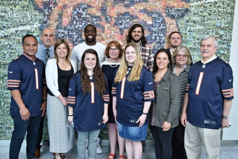 Symetra and the Chicago Bears celebrated the 16 Chicago-area teachers recognized as Symetra Heroes in the Classroom during the 2017 NFL season at a special reception at Halas Hall on May 18. Chicago Bears Linebacker Sam Acho (2nd left, rear row) was a surprise guest. (Photo: Business Wire)