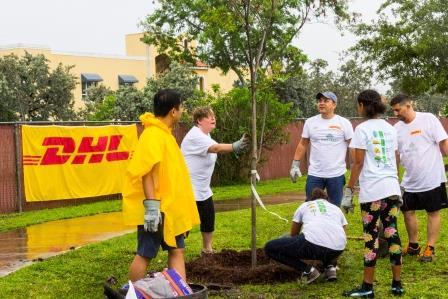 South Florida-based DHL employees and their families planted 40 trees at the Norman and Jean Reach Park in the City of Hialeah in Miami-Dade County on May 19, as part of the company's mandate to plant 1 million trees annually around the world, part of the company's ambitious goal to achieve net zero transport-related emissions by the year 2050. (Photo: Business Wire)