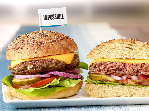 The first Impossible kosher cheeseburger prepared with kosher American cheese, kosher dill pickles, red onion, lettuce and tomato on a kimmelweck roll. (Photo: Business Wire)