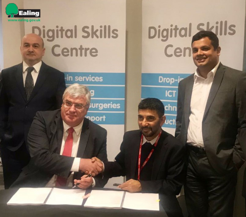 Edward Axe - Director ICT, IDM & CIO, Ealing Council (Left) with Pradeep Kar - Founder & CMD, Microland (Right), after signing the partnership (Photo: Business Wire)
