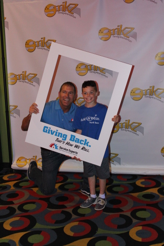Service Experts Chief Executive Officer Scott Boose and Wish Child Payton are pictured at the 2018 Service Experts Bowl-A-Thon at Strikz in Frisco. (Photo: Business Wire)