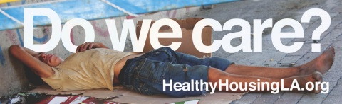 The 'Do We Care?' billboard (with English & Spanish versions) features a stark image of a homeless person asleep on a sheet of cardboard on a sidewalk or the pavement—a horizontal image of an individual stretching the entire 48 foot length of (most) billboard postings—and one that underscores just how widespread the homeless crisis is in Los Angeles. (Graphic: Business Wire)
