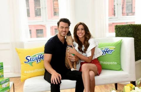 Kevin and Danielle Jonas enjoy puppy kisses from an adorable and adoptable dog from Bideawee Animal Shelter at the Swiffer #ShedHappens event on Wednesday, May 23, 2018, in New York. (Photo: Business Wire)
