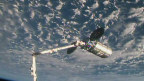 The International Space Station's robotic arm is seen grappling Orbital ATK's Cygnus spacecraft on May 24, 2018. Credit: NASA TV