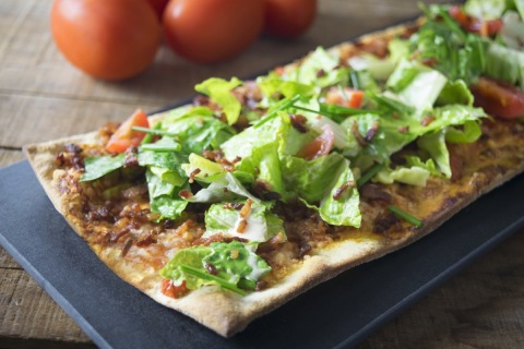 Chipotle BLT Flatbread: Chipotle red sauce, Applewood bacon, fresh tomato and zesty-ranch dressed romaine atop Hilton Garden Inn's signature flatbread (Photo: Business Wire)
