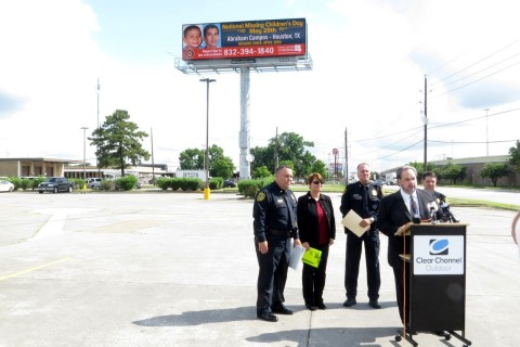 Clear Channel Outdoor's Lee Vela stands with the Texas Center for the Missing, and local officials, to launch a month-long digital billboard campaign to bring home missing Texas children. (Photo: Business Wire)