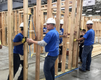 (Center) Scott Cannon, CEO at BigRentz, and team build a house frame for Habitat for Humanity of Orange County during Leaders Build. (Photo: Business Wire)