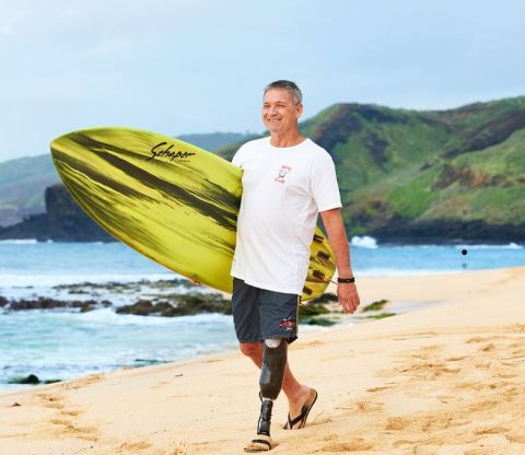 Unum customer David Connor never expected to be in a position where he couldn't work, but a routine task at work altered his life forever. His disability coverage helped provide financial stability while he took time away from work to recover. He's now working again and has returned to his passion - surfing. (Photo: Business Wire)