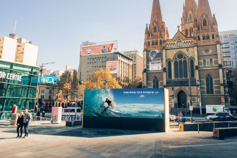 Corona advertisement before being hijacked with 1500KG plastic wave to raise awareness for marine plastic pollution. (Photo: Business Wire)