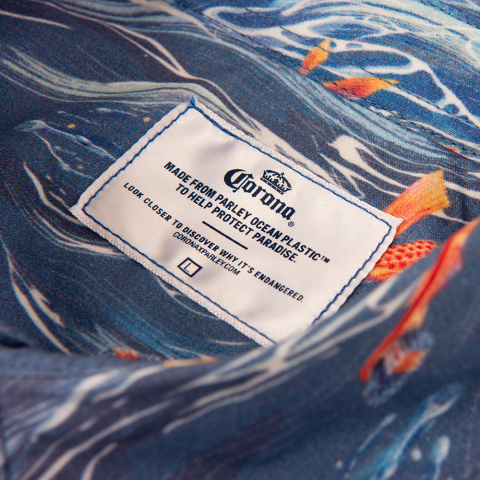 Corona and Parley for the Oceans redesign the Hawaiian shirt to spread awareness about the issue of marine plastic pollution this Oceans Week. The design features everyday plastic items and is made from Parley Ocean Plastic(TM) that is collected from the ocean.(Photo: Business Wire)e)