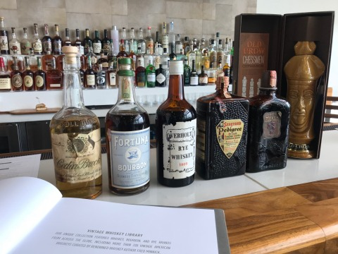 The whiskey library features more than 200 vintage American whiskeys curated by renowned whiskey author Fred Minnick. The collection includes extremely rare gems, including an 1890s Cedar Brook whiskey and a pair of early 1900s Overholt Rye, and tells the story of American whiskey, through each bottle, from the late 1800s and pre-prohibition through the 1950s, 60s, 70s, and 80s. (Photo: Business Wire)