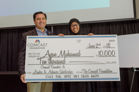 Ayan Muhumed of West Salem High School in Salem, Oregon receives a $10,000 Comcast Founders Scholarship from Rodrigo Lopez, Regional Senior Vice-President of Comcast Oregon/SW Washington. She will be the first woman in her family to go to college. She plans to attend Portland State University to become a social worker. (Photo: Business Wire)