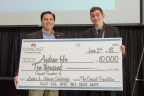 Andrew Ho, right, of Portland's Cleveland High School receives $10,000 Comcast Founders Scholarship from Rodrigo Lopez, Regional Senior Vice-President of Comcast Oregon/SW Washington. Ho plans to attend USC to study International Relations. (Photo: Business Wire)