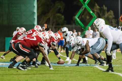 Players assemble at the line of scrimmage during Your Call Football's inaugural game. (Photo: Business Wire)