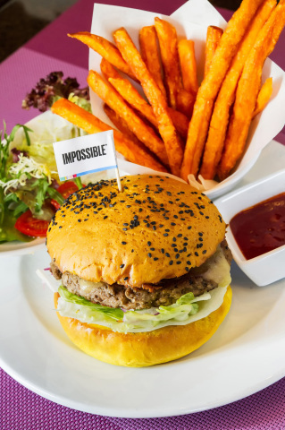 InterContinental Grand Stanford Hong Kong introduces the Impossible Indian Burger at Café on M, prepared on a turmeric bun topped with cheese, onion bhaji, cucumber yoghurt, and spicy pickles, served with sweet potato fries. (Photo: Business Wire)