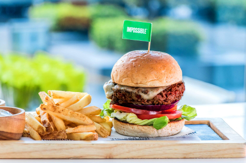 The Impossible Burger, served on a vegan bun, topped with gouda, onions and pickles, at Hotel ICON's GREEN. (Photo: Business Wire)