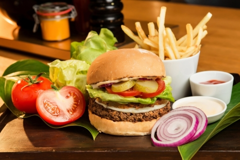 The Impossible Burger at Grand Hyatt Hong Kong, topped with veganaise, Daiya provolone, a sweet potato rustique, and herbs. (Photo: Business Wire)