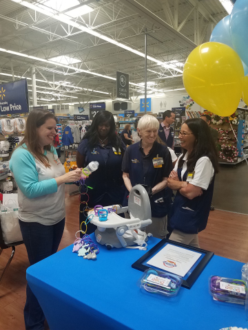 JoyLynn Waganer of St. Peters, MO-based The Drop Stoppers talks with Walmart associates following her invitation to Open Call. (Photo: Business Wire)