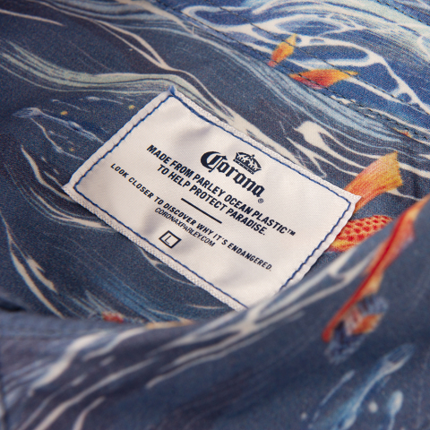 Corona and Parley for the Oceans redesign the Hawaiian shirt to spread awareness about the issue of marine plastic pollution this Oceans Week. The design features everyday plastic items and is made from Parley Ocean Plastic that is collected from the ocean. (Photo: Business Wire)