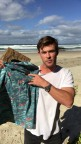 Chris Hemsworth spreads awareness about protecting paradise during Oceans Week with new shirt designed by Corona to show the realities of plastic pollution ruining our oceans. (Photo: Business Wire)