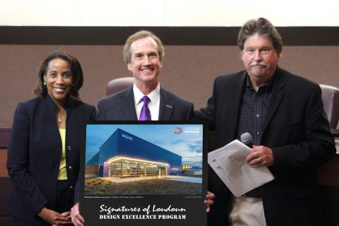RagingWire Vice President of Marketing James Leach holds the Signatures of Loudoun Design Excellence Award, flanked by Loudoun County Chair of the Board of Supervisors Phyllis Randall (left) and Loudoun County Design Cabinet Chair Alan Hansen (right). (Photo: Business Wire)